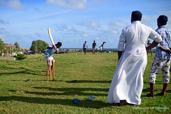Young men playing amateur cricket game in UNESCO World Heritage, Galle Fort, during Binara Full Moon Poya Day.